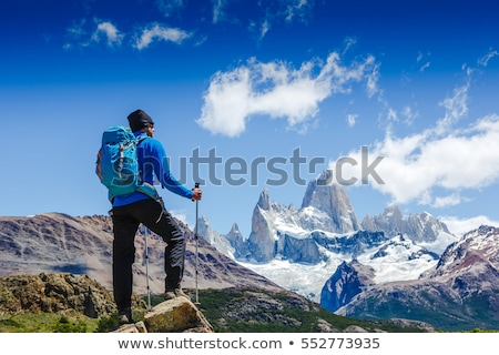 Hiking man looking at beautiful inspirational landscape stock photo © blasbike