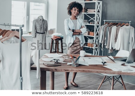 Fashion designers looking at dress Stock photo © IS2