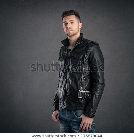 Retrato bonito moço jaqueta de couro óculos de sol Foto stock © deandrobot