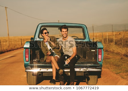 Man sitting on side of pickup truck Stock photo © IS2