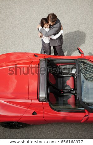 Business couple huging near electric car Stock photo © IS2