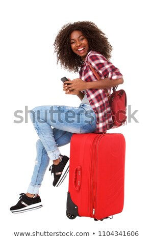 Woman on the phone, sitting on luggage Stock photo © IS2