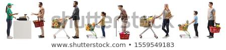Young man with supermarket trolley cart Stock photo © studioworkstock