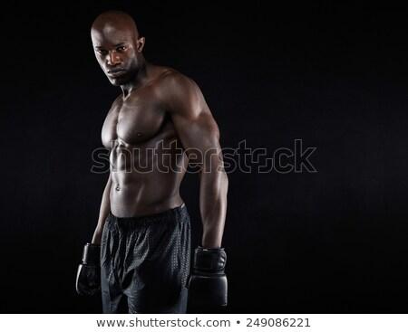 Portrait of a muscular shirtless sportsman Stock photo © deandrobot