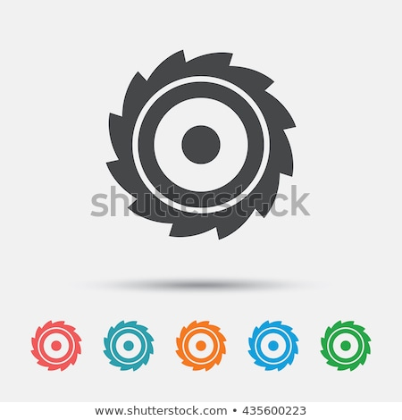 circular saw blade on blue background stock photo © m_pavlov