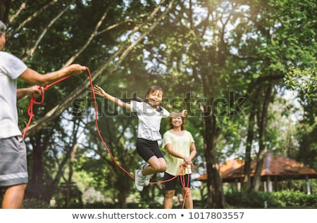 Mother and daughter jump rope Stock photo © bluering