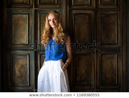 женщину синий блузка темно стены портрет Сток-фото © dashapetrenko