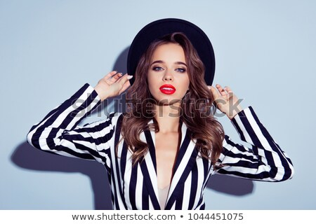 beautiful young woman with fancy hairdo and red lips stock photo © svetography
