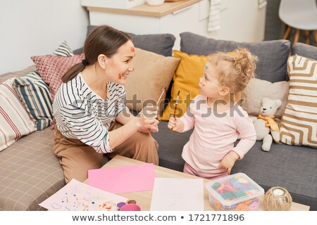 Young mother looking at her daughter Stock photo © acidgrey