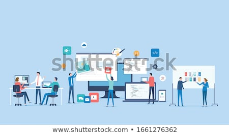 Business people work together in office with workstation in the foreground. Concept of teamwork and  Stock photo © alphaspirit