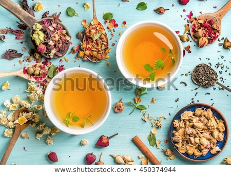 Foto d'archivio: Spoons With Different Types Of Dry Tea Leaves