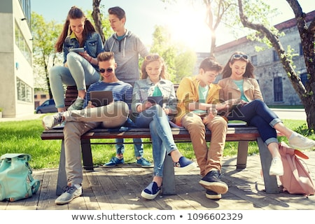 group of students with tablet pc at school yard stock photo © dolgachov