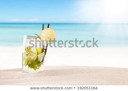 refreshing cocktail with slice of orange on beach stock photo © robuart