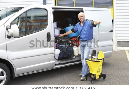 Cleaner standing next to van Stock photo © monkey_business