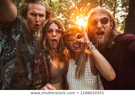 Photo of joyful hippie people men and women, taking selfie in fo Stock photo © deandrobot
