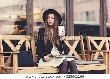 Swag brunette girl drinking coffee at street. stock photo © studiolucky