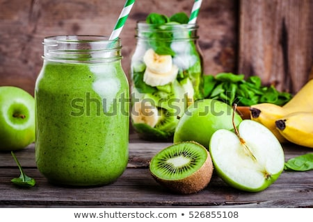 fresh juicy detox homemade smoothies in glass mason jar from celery on a duotone background in color stock photo © artjazz