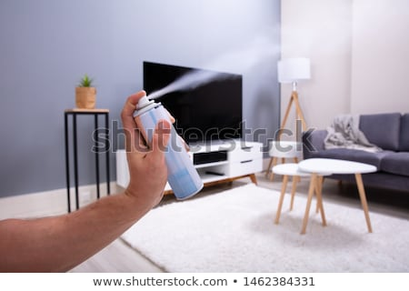 Human Spraying Air Freshener Stock photo © AndreyPopov