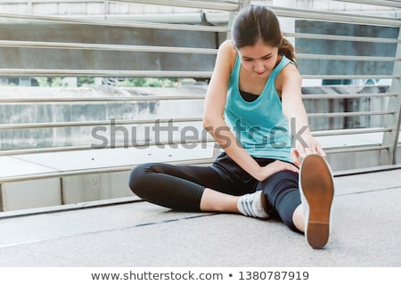 beautiful fit sportswoman doing warming up exercises stock photo © deandrobot