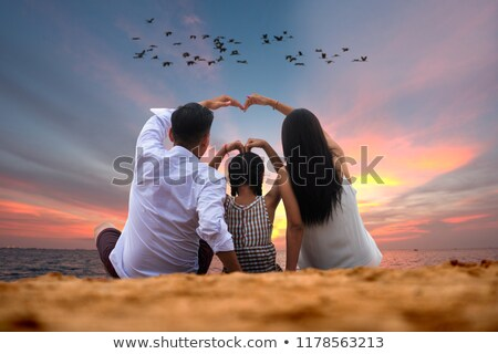 Happy family jumping together on the beach, Thailand Stock photo © Yongkiet