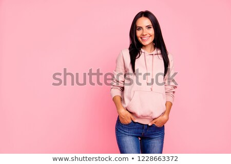 Sporty student in jeans smiling Stock photo © nyul