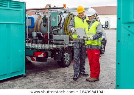 Workers doing some logistics in the rental toilet business Stock photo © Kzenon