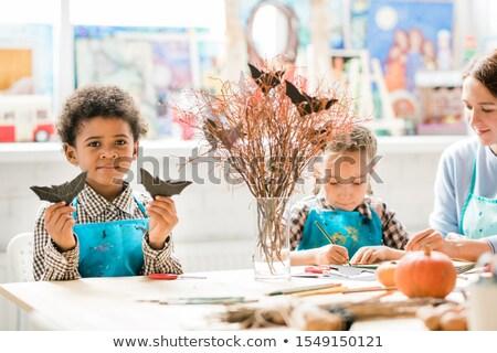 один молодой Одноклассники ручной работы черный Сток-фото © pressmaster