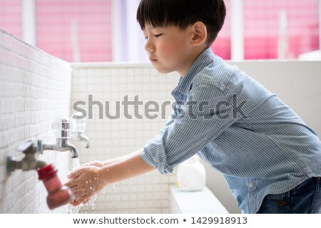Aranyos fekete fiú mosás kezek betegség Stock fotó © zkruger