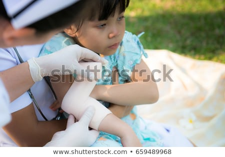 Girl Elbow With An Adhesive Bandage Stock photo © AndreyPopov