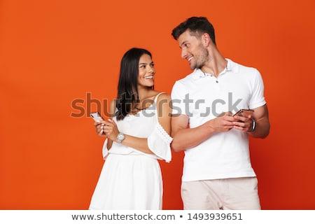 pleased happy young amazing loving couple stock photo © deandrobot