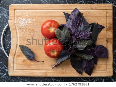 Two red tomatos and purple basil leafs Stock photo © dmitroza