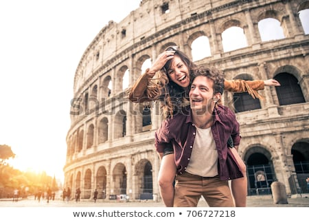 Young couple traveling together, travel to Rome, woman and man telling about visited town, player Stock photo © robuart