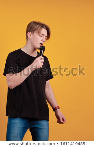 Blond Rocker Singing into microphone Stock photo © dnsphotography