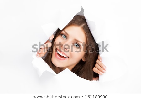 woman looks in the hole of the sheet of paper Stock photo © Paha_L