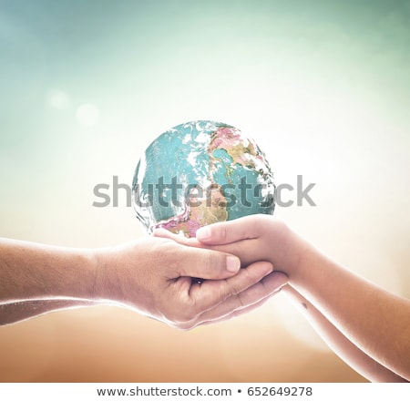 The globe in hands of the child Stock photo © dashapetrenko