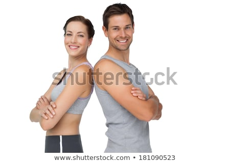 Slender Caucasian Woman in Sports Bra Smiling White Background Stock photo © Qingwa