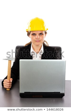 thoughtful woman in a hardhat sitting at a desk stock photo © photography33