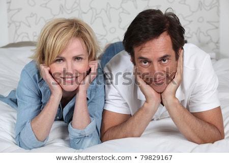 çift yatak adam oda portre Stok fotoğraf © photography33
