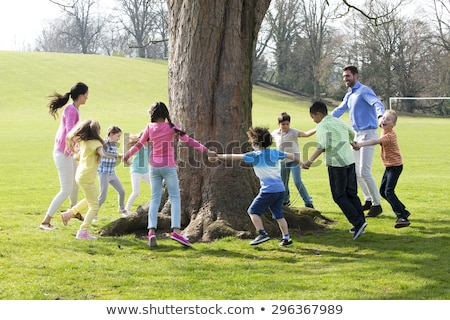 adult family around a tree stock photo © photography33