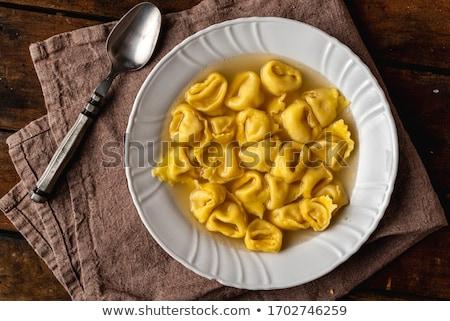 Tortellini közelkép bazsalikom paradicsomszósz étel vacsora Stock fotó © ca2hill
