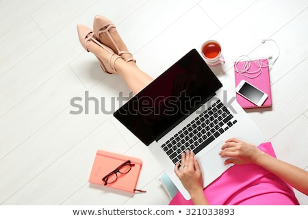 Cute girl lying on floor with a laptop stock photo © williv
