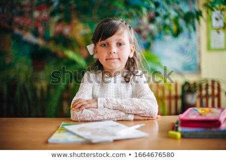 portret · jong · meisje · school · bureau · shot · vergadering - stockfoto © HASLOO