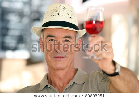 old man raising a glass of claret stock photo © photography33