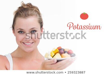 Young fair-haired woman eating grapes Stock photo © photography33