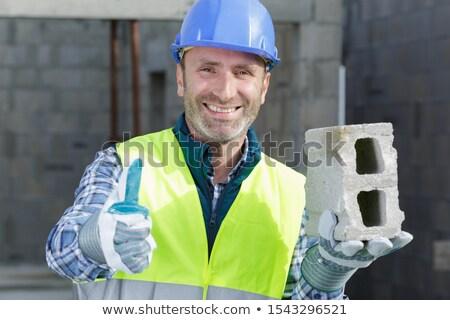 Férfi tart szellő épület építkezés fém Stock fotó © photography33