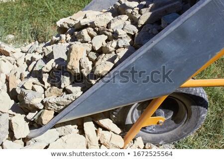 Laborer lying in a wheelbarrow Stock photo © photography33