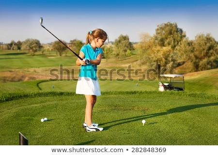 Jovem jogador de golfe menina atraente campo de golfe motorista Foto stock © epstock