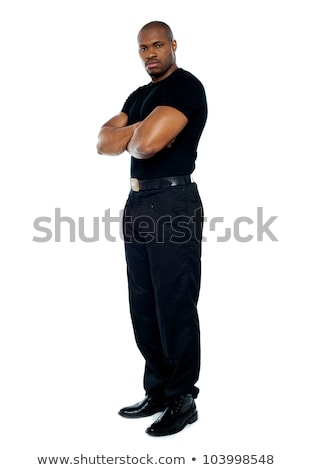 male security guard with strong arms crossed stock photo © stockyimages