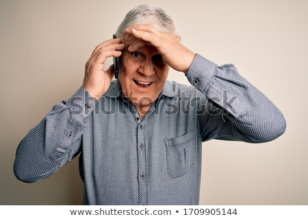 Surprised man talking on the phone stock photo © photography33