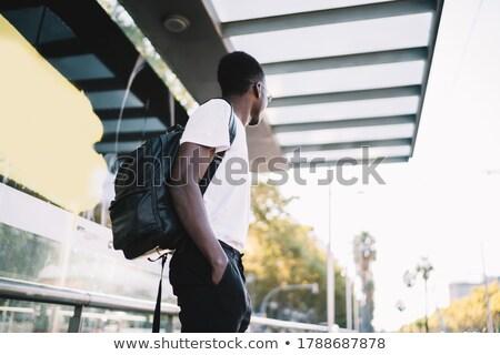 Stock photo: Man On Street In White Shirt And Dark Eyeglasses
